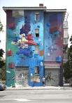Grande parete esterna Quartiere San Donato Bologna - Frontier | La linea dello stile