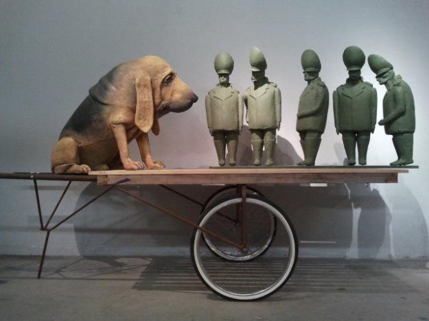 Dog and Soldiers, 2012. Cartapesta, colore acrilico, 200x120cm